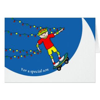 Tarjeta Navidad para el hijo, el Skateboarding y las luces