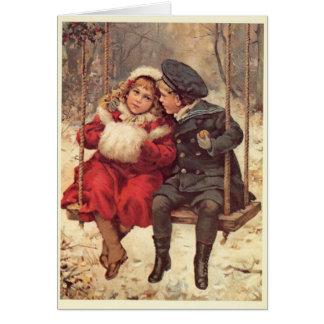 Tarjeta Niños en navidad de un oscilación
