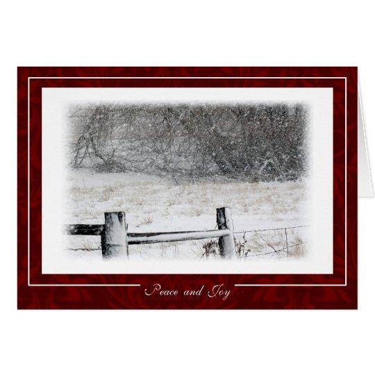 Tarjeta Paz del navidad y escena del invierno Nevado de la