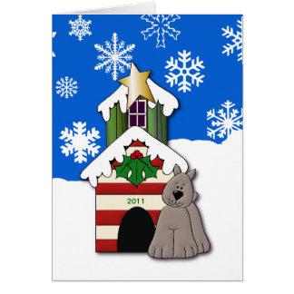Tarjeta Perro del navidad del copo de nieve con la caseta