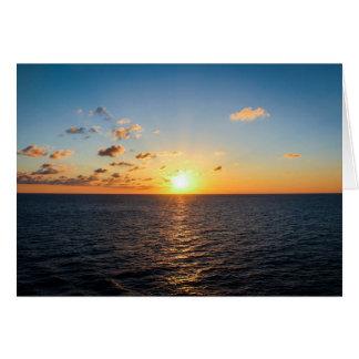 Tarjeta Puesta del sol sobre el Océano Atlántico