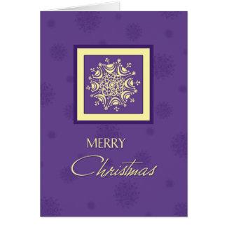Tarjeta púrpura de las Felices Navidad de los copo