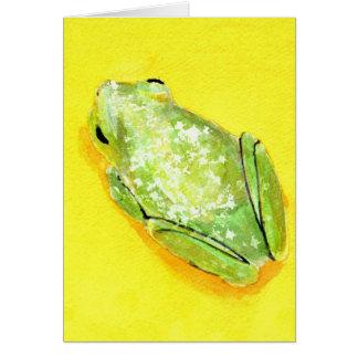 Tarjeta Rana verde en watercolour amarillo del fondo