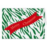 Tarjeta roja de las Felices Navidad de la cinta de