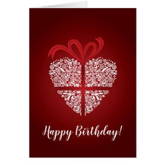 Tarjeta roja del feliz cumpleaños con el ornamento