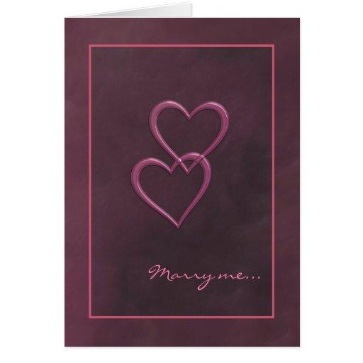 Tarjeta rosada de la propuesta de matrimonio de lo