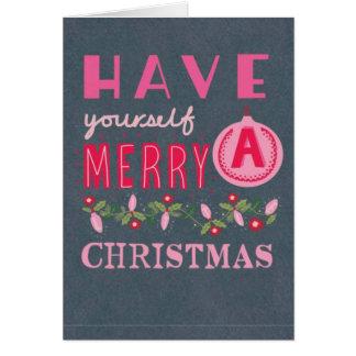 Tarjeta rosada de las Felices Navidad