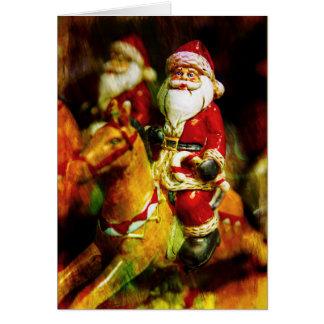 Tarjeta Santa monta un carrusel