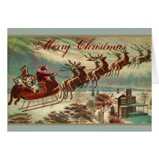 Tarjeta Santa y su navidad del trineo del reno
