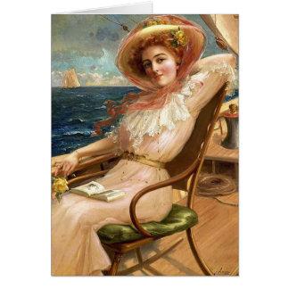 Tarjeta Señora On una cubierta del velero,