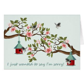 Tarjeta triste con los pájaros y la magnolia