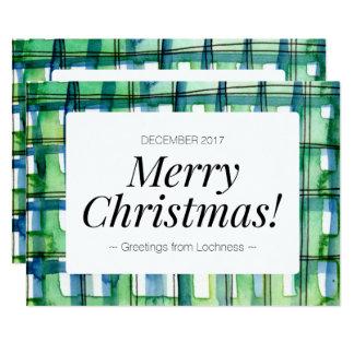 Tarjeta verde de las Felices Navidad de la tela
