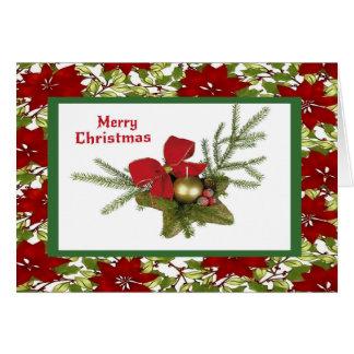 Tarjeta Verdor del navidad en fondo del Poinsettia