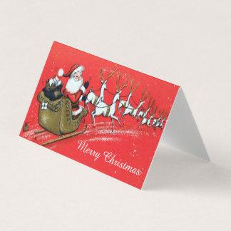 Tarjeta Vintage Papá Noel en su trineo con el reno