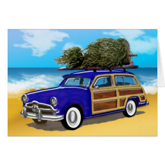 Tarjeta Woodie que practica surf con el árbol de navidad