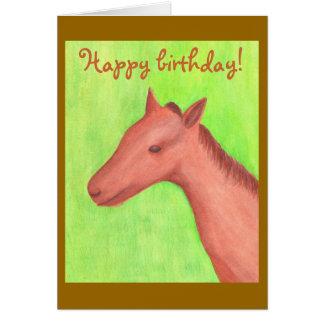 Tarjetas del feliz cumpleaños con un caballo joven
