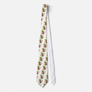 Tarsier que oculta debajo de una hoja verde corbatas