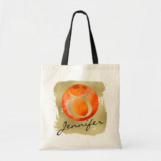 Tauro anaranjado de la muestra del zodiaco en bolso de tela