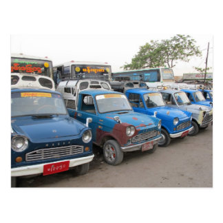 Taxis azules viejos de Mazdas Postal