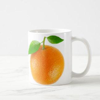 Taza anaranjada de la fruta