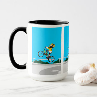 Taza BMX  niño en su bicicleta tomando impulso