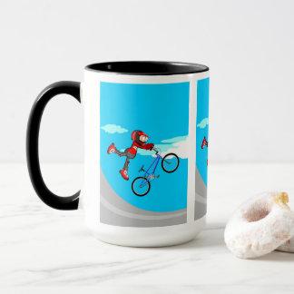 Taza BMX  niño en su bicicleta volando por el aire