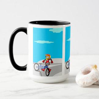 Taza BMX  niño naciendo piruetas con su bicicleta