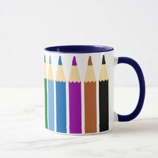 Taza coloreada del lápiz para los profesores o los