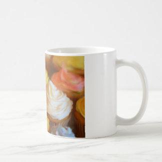 Taza colorida de las magdalenas