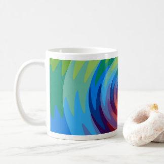 Taza colorida del arco iris