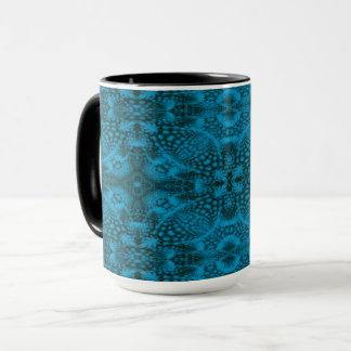 Taza combinada del caleidoscopio negro y   azul