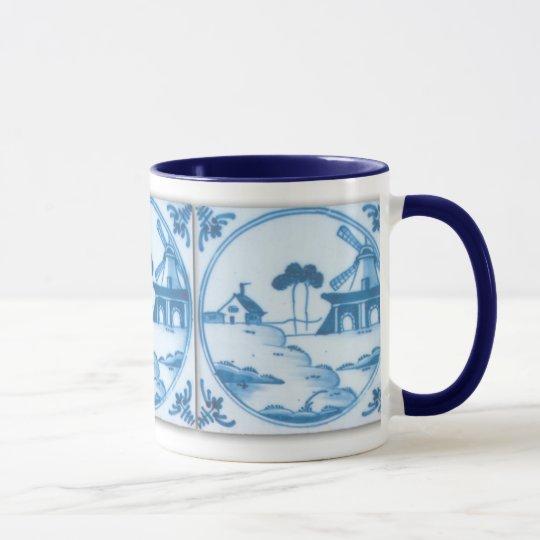 Taza de café blanca azul del molino de viento de