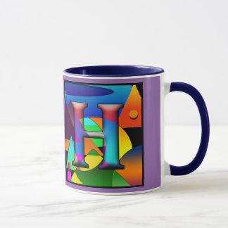Taza de café con las iniciales E y H