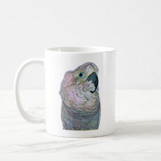Taza de café con un cockatoo del bebé