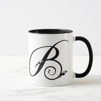 Taza de café de dos tonos con inicial