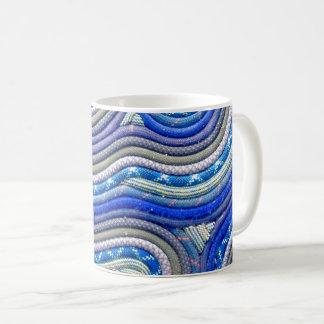 Taza de café de la cuerda que sube