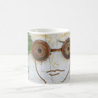 Taza de café de las gafas del individuo loco del