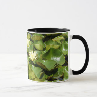 Taza de café del lirio de agua