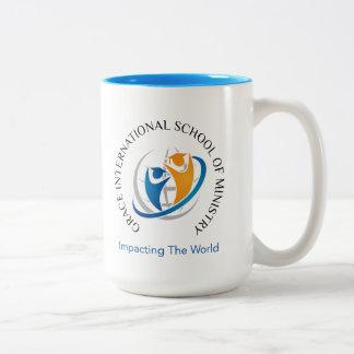 Taza de café del logotipo de la escuela