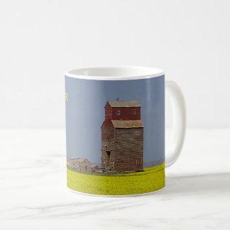 Taza de café del paisaje del elevador de la