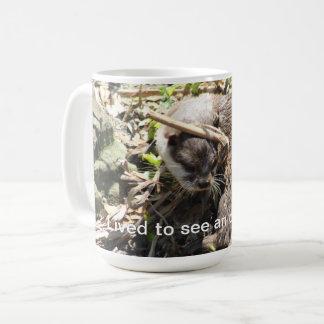 Taza de café divertida de la nutria