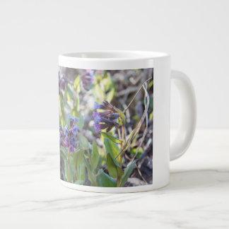 Taza de café enorme de la mañana