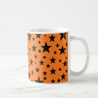 Taza De Café Estrellas del negro con el fondo anaranjado