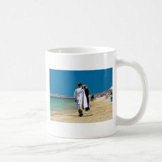 Taza De Café Vendedor en la playa