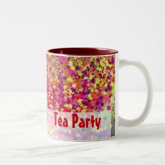 Taza de la fiesta del té de la primavera