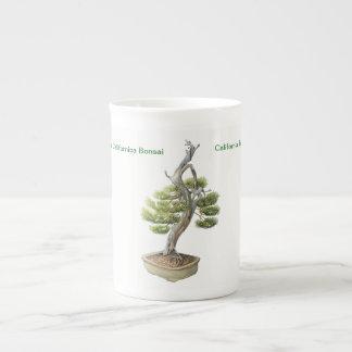 Taza de la porcelana de hueso de los bonsais