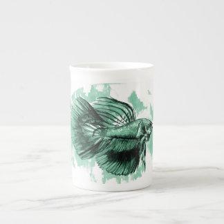 Taza de la porcelana de hueso de los pescados de