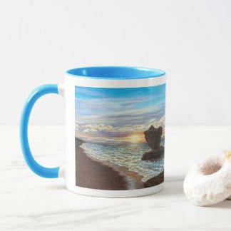 Taza de la puesta del sol de la roca de la taza de
