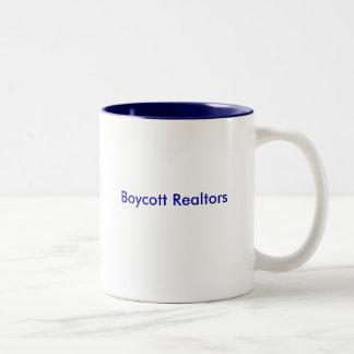 Taza de los agentes inmobiliarios del boicoteo