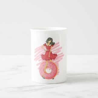 Taza De Té Chica con el buñuelo